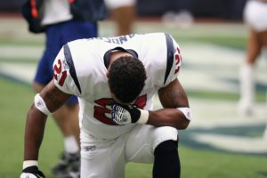 NFL Player Praying